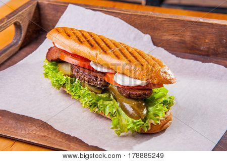 Ciabatta Sandwich With Fried Beef, Lettuce, Slices Of Fresh Tomatoes And Pickled Cucumber, Mozzarell