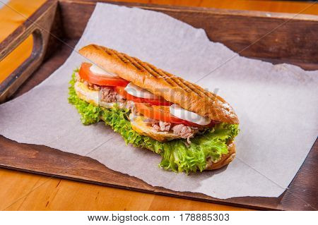 Ciabatta Sandwich With Tuna, Lettuce, Slices Of Fresh Tomatoes, Scrambled Eggs And Mozzarella Cheese