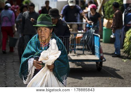 Otavalo Ecuador - February 1 2014: Indigenous woman in a market the town of Otavalo in Ecuador.