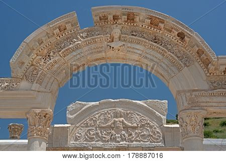 Pattern and sculptures in ancient ruin in Ephesus (Turkey). Blue sky in background.
