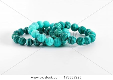 Beautiful Amazonite or Amazon stone beads in bracelets on white background