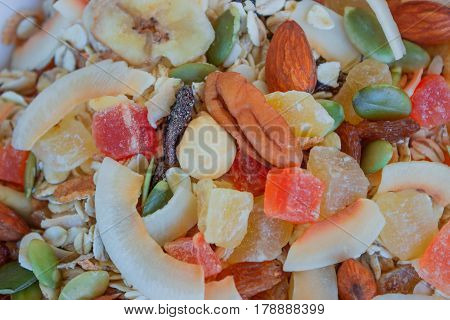 Muesli with dried fruits candied fruits nuts and pumpkin seeds. Concept - healthy breakfast. Background.