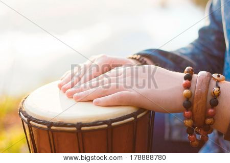 Playing the djembe. Beautiful stylish ethnic picture.