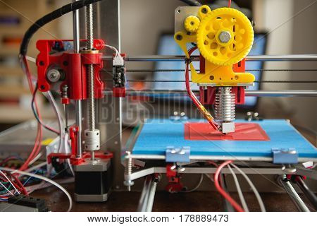 3d the printer prints a part from a polymeric material. New technology for manufacturing parts.