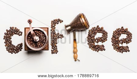 Top View Of Word Coffee Made From Coffee Beans And Coffee Mill With Turkish Coffee Pot