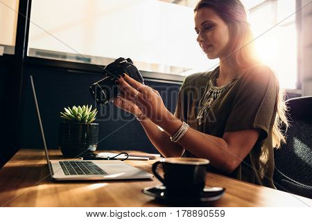 Young Female Vlogger Watching Her Camera While Editing Her Vlog