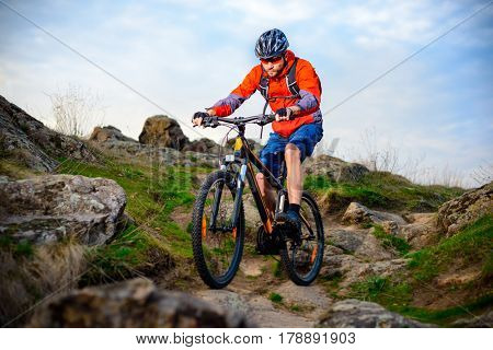Cyclist Riding the Mountain Bike on the Beautiful Spring Rocky Trail. Extreme Sport Concept