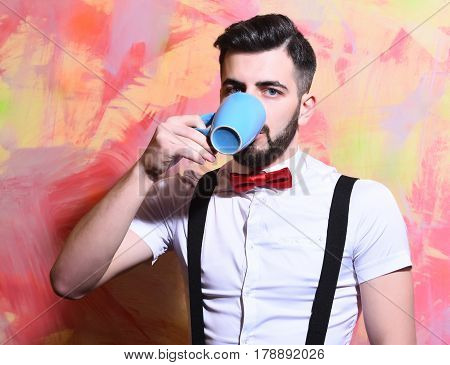 Bearded Man Drinking Tea Or Coffee With Serious Face