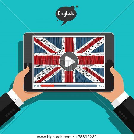 Concept of learning languages. Study English of Britain. Hand drawn english flag on the tablet screen. Film in English.