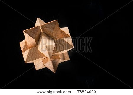 The wooden puzzle - game with blocks on black