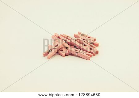 A set of pink wooden clothespins on white background