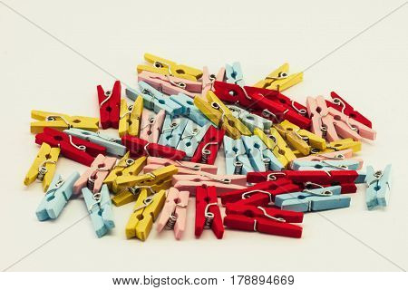A set of colored wooden clothespins on white background