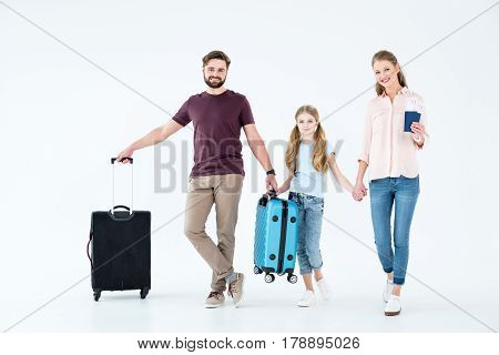 Young Family With Passports, Tickets And Traveling Bags On White