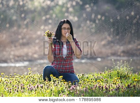 Girl With Allergic Reaction On Flowers In Field