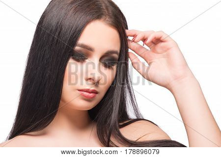 Beauty woman face portrait with clean fresh skin long hair and bright evening make up looking down.Isolated on white background