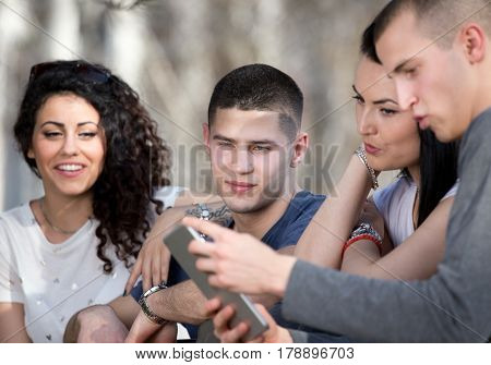 Friends With Tablet On Bench