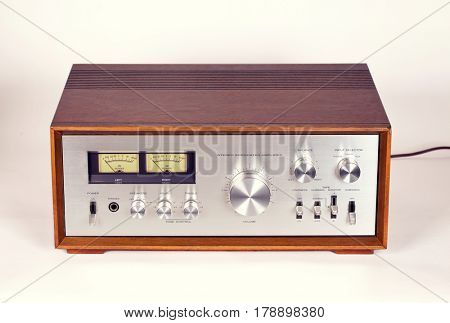 Vintage Stereo Audio Amplifier in Wooden cabinet frontal view