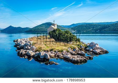 Small Island With A Very Old Lighthouse Located In Southern Croatia, Dalmatia