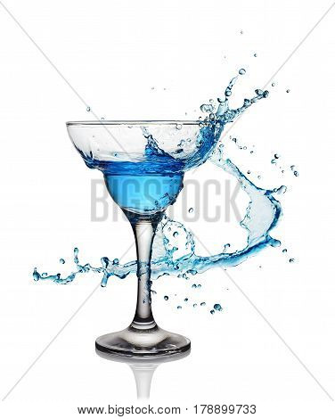 Splash In Glass Of A Blue Alcoholic Cocktail Drink
