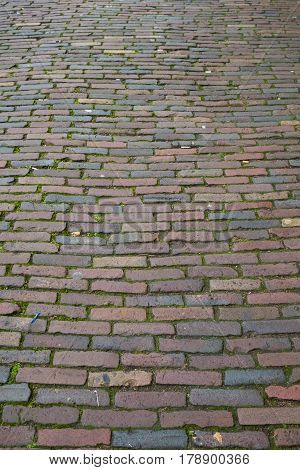 Background texture of a cobbled street in colour.