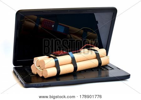 sticks of dynamite with mobile phone and laptop