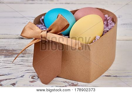 Heart shaped box, Easter eggs. Blank card and bow. Send gifts this Easter.