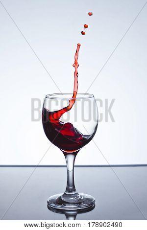 Red wine splash over white background on a white background freezing