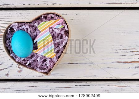 Easter egg, heart shaped box. Colorful paper rabbit cutout. Fresh ideas for cute presents.