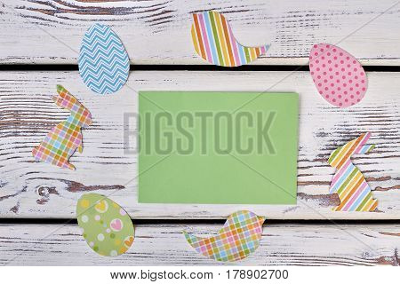 Blank card, Easter paper cutouts. Empty paper on white wood.