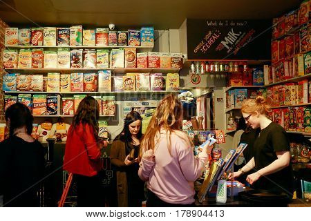 LONDON, UK - MARCH 18, 2017: Customers placing orders in Cereal Killer, the Worlds first International Cereal Cafe.