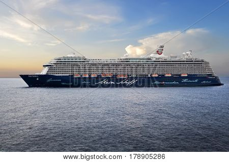 MONTE CARLO, MONACO - OCTOBER 07, 2014: Cruise ship Menie Schiff 3 owned by TUI Cruises, standing still in the open sea next to the port of Monte Carlo