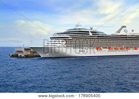 MONTE CARLO, MONACO - OCTOBER 07, 2014: Oceania Cruises ship Marina  docked at port of Monte Carlo. Marina blends sophistication with a contemporary flair to create a casually elegant ambiance