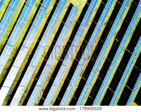 Aerial photo of solar power plant.  Industrial background on renewable resources theme.