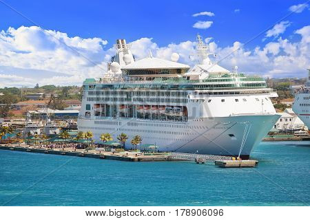 NASSAU, BAHAMAS - APRIL 13, 2015: Royal Caribbean cruise ship Grandeur of the Seas docked at port on the sunny day