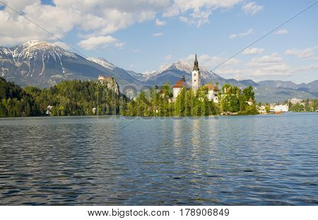 Pilgrimage Church And Rocktop Castle With Mountain Landscape Background, Bled Lake, Slovenia