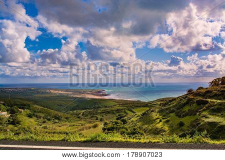 Sintra Portugal. 25 March 2017.View of Guincho beach and green fields sourouding from the road to Cabo da Roca in Sintra Portugal. Sintra Portugal. photography by Ricardo Rocha.
