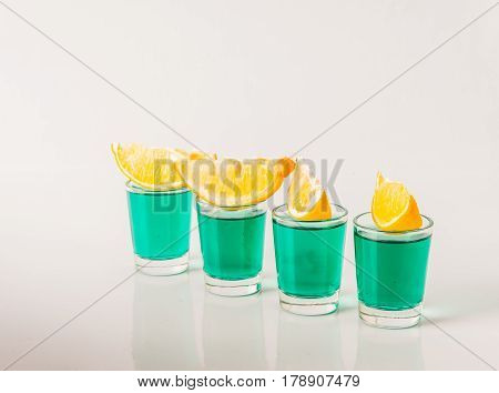 Glasses With Green Kamikaze, Glamorous Drinks, Mixed Drink Poured Into Shot Glasses