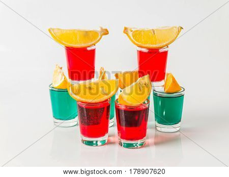 Glasses With Green And Red Kamikaze, Glamorous Drinks, Mixed Drink Poured Into Shot Glasses