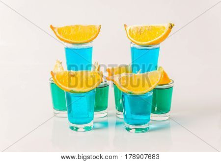 Glasses With Blue And Green Kamikaze, Glamorous Drinks, Mixed Drink Poured Into Shot Glasses