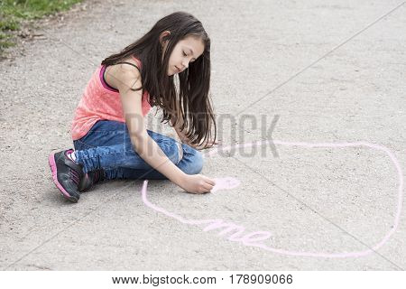 Girl drawing circle of intimate zone. Selective focus