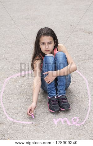 Preteen girl sitting in a circle on the ground