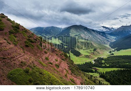 view on the picturesque mountain gorge with red land in Tien Shan mountains Kyrgyzstan