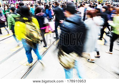 People Crossing A Street In Hong Kong With Motion Blur