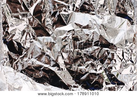 Texture Of Foil Paper Of Silver Color With Reflection. Wrinkle Aluminum Foil Background Texture. Sil