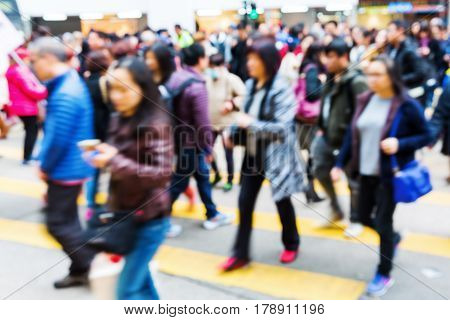 People Crossing A Street In Hong Kong Out Of Focus