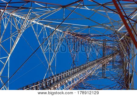bottom view of telecommunication tower with blue sky