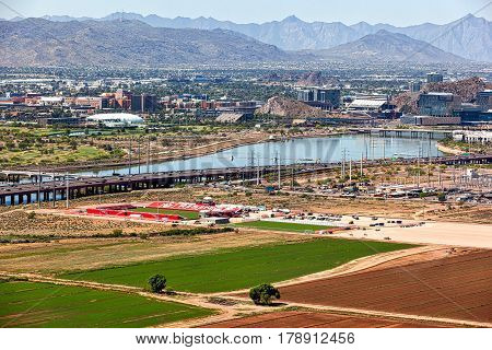 Rising skyline and sports activity along the Tempe Town Lake