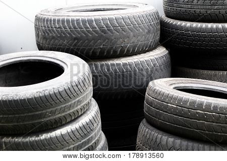 Old Used Car Tires Stacked In High Piles..