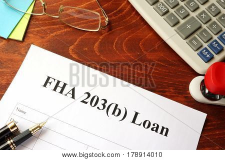 FHA 203b loan policy in an office.