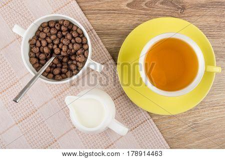 Chocolate Corn Balls In Bowl, Jug Of Milk On Napkin